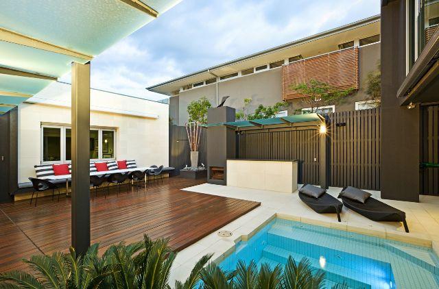 Stone 101 used Bianco Limestone to surround the pool. www.stone101.com.au