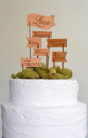 Moss wedding cake topper with message flags. Very unique.