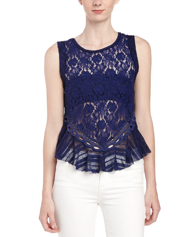 Love the color and lace. Back is awesome, too.  Free People Dark Bloom Lace Tank is on Rue. Shop it now.