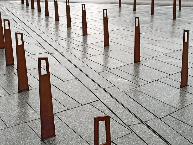 Corten poles and bikestands and light grey granite pavement at KPMG HQ in Copenhagen, Denmark. Landezine Landscape Architectures Works