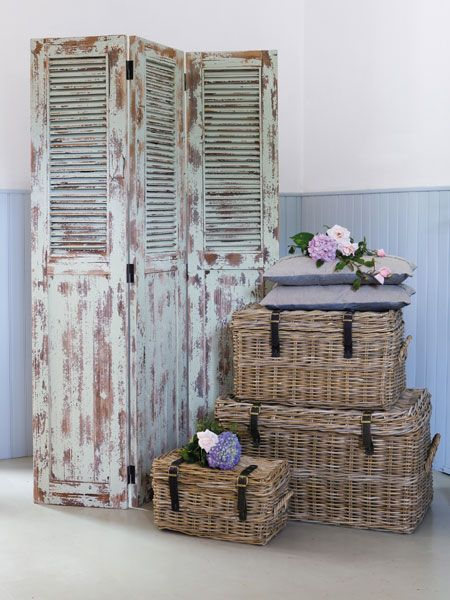 repurposed .. shutter doors - could use these for privacy on the front porch.