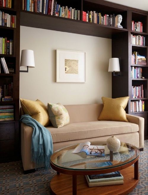 Having a bookshelf doesn't have to take up so much square footage in your living room anymore! Simply install a bookshelf over the sofa and voila! <3