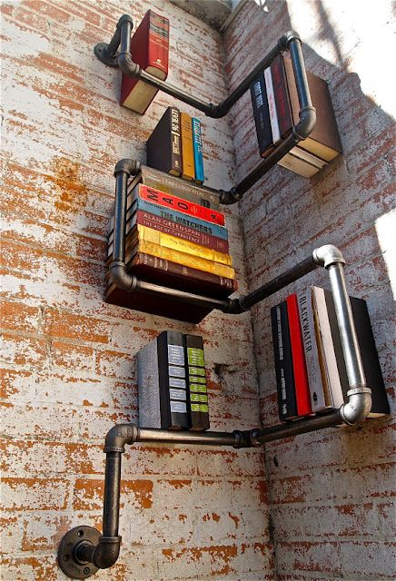 Bookshelves crafted from industrial pipe --- would have so used this in my last home. (I made a spice rack from aluminum commercial electrical boxes. -- this would have been amazing for books!)