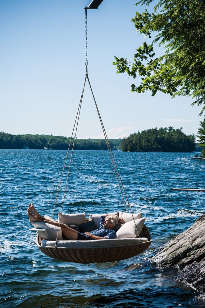 Swing out over the water and catch those cool breezes on a hot summer day -- or night, because it's big enough to sleep in! #swings #outdoors