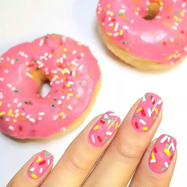 Pink sprinkled doughnut nails! What a coincidence, I just watched smosh's food battle and this is Ian's food!