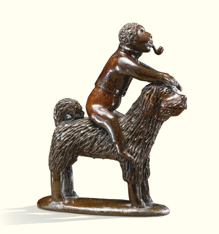 Rare glazed red earthenware pipe-smoking monkey riding a dog, Solomon Bell (1817-1882)<br>Strasburg, Shenandoah County, Virginia, 1850-1870 | Lot | Sotheby's