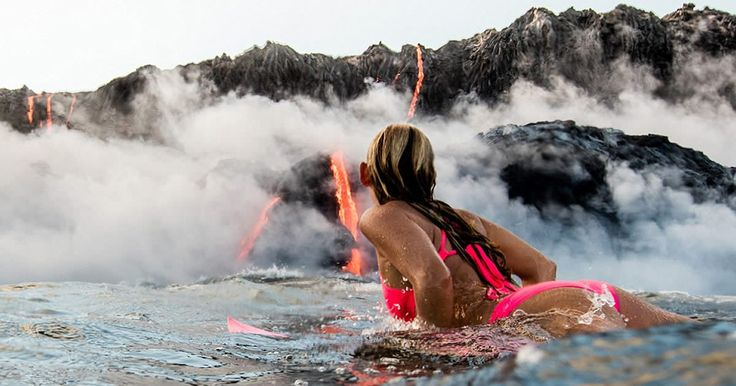 Alison Teal the first woman to surf out to the base of an erupting volcano and swim surrounded by flowing lava - 9GAG