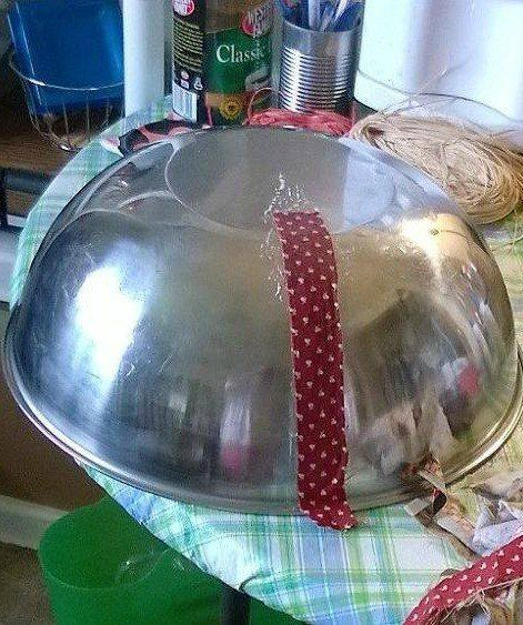 She lays a long fabric strip on a mixing bowl. A few steps later? I love this countertop idea!