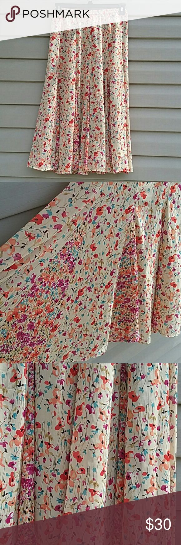 Coldwater Creek maxi skirt NWOT Coldwater Creek flowy maxi skirt stretchy waist, beautiful cream color with red, Orange,  purple, tan, and  Blue flowers never worn size XS petite Waist is26 in. Length is 31 in. Coldwater Creek Skirts Maxi