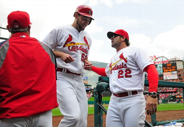 Michael Wacha is congratulated by manager Mike Matheny after scoring on a double by Matt Carpenter  during the second inning against the Chicago Cubs. Cards won 5-3.  5-15-14