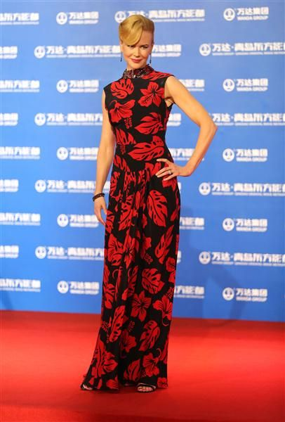 Lady in RedPrints are tough. But perhaps thanks to her height, Nicole Kidman pulled off a leaf-and-floralpattern Prada gown -- bonus points for that jeweled neckline -- at the Wanda Group's Qingdao Oriental Movie Metropolis Opening Ceremony in Qingdao, China, on Sept. 22, 2013.Like us on Facebook?