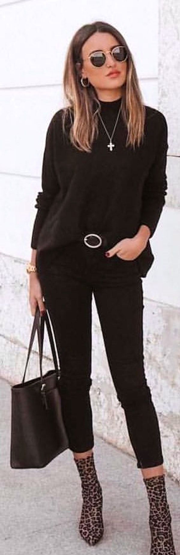 #spring #outfits woman in black crew-neck sweatshirt, black leggings, black leather tote bag and brown pointed-toe heels outfit. Pic by @ootdmagazine