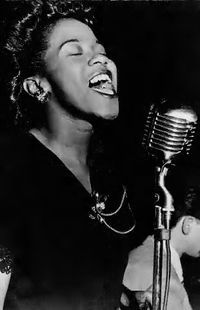 """Sarah Lois Vaughan (March 27, 1924 – April 3, 1990) was an American jazz singer. She has been described by music critic Scott Yanow as having """"one of the most wondrous voices of the 20th century.""""  Nicknamed """"Sassy"""" and """"The Divine One"""", Vaughan was a four-time Grammy Award winner, including a """"Lifetime Achievement Award"""". The National Endowment for the Arts bestowed upon her its """"highest honor in jazz"""", the NEA Jazz Masters Award, in 1989."""
