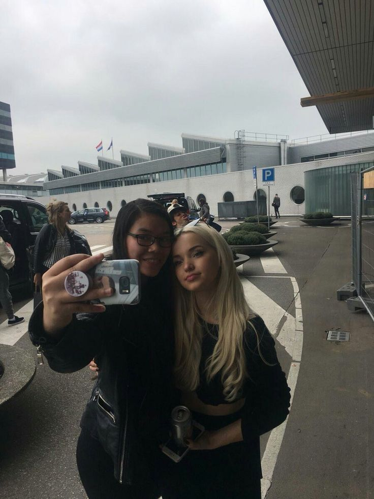 Dove Cameron with a fan.