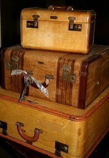 """a vignette of vintage suitcases can add that special """"well traveled"""" look + decorative charm to your room : mix with many styles"""