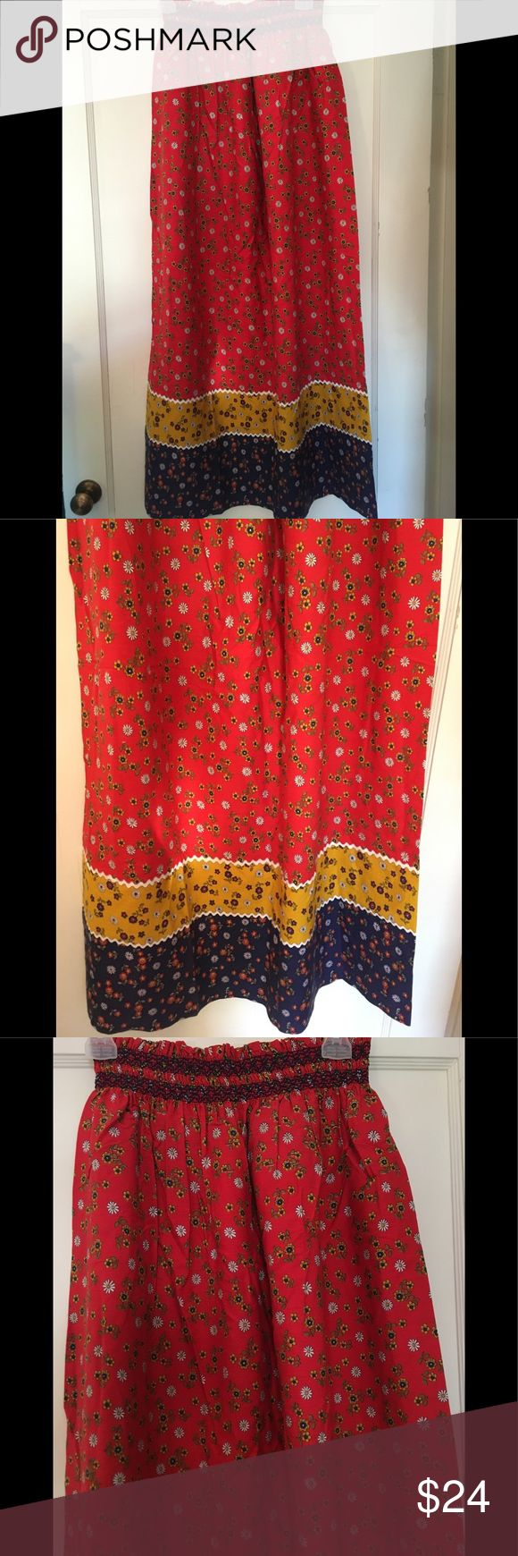 Handmade European Folk Skirt This vibrantly colored folk skirt is 13 inches across the waist and 42 inches long. The bottom is not hemmed so maybe shortened. The waste is elastic and has some give to it. Great colors of red, blue and mustard with flowers throughout make this a fun skirt for festivals and dress up Vintage Skirts Maxi