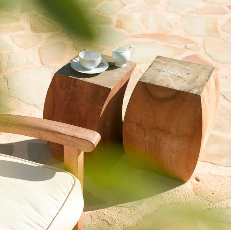 Tribu 'Twins' teak side tables  http://www.coshliving.com.au/outdoor-products/outdoor-accessories/