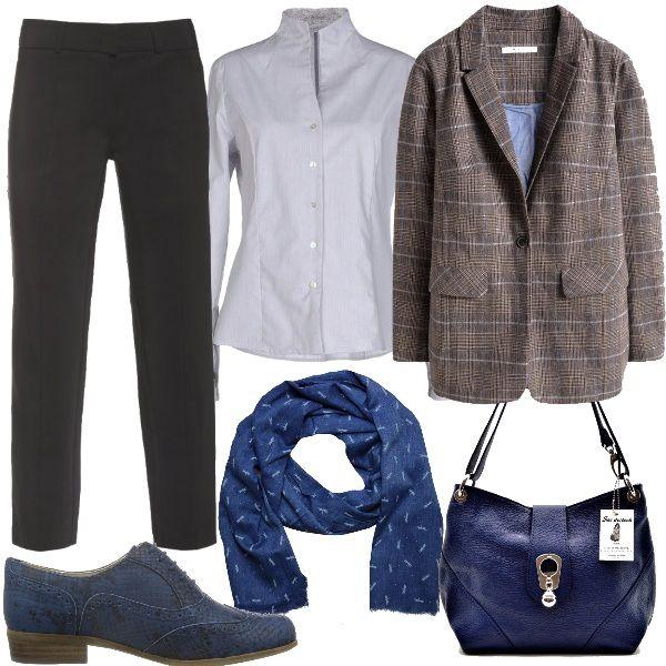 Pantaloni a sigaretta neri abbinati ad una camicia con collo alla coreana e ad una giacca a quadri dalla vestibilità comoda. Foulard bluette come la borsa e le scarpe che sono in stile inglese ma pitonate. Uno stile maschile ricercato negli accessori.