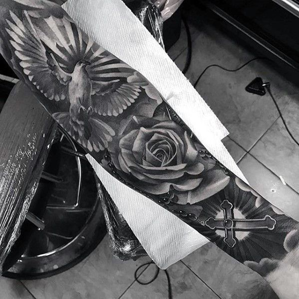 Badass Sleeve Tattoo With Cross Rose Flower And Flying Dove For Men #tattoosformensleeve