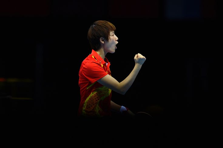 China's Ding Ning reacts after winning a point against South Korea's Kim Kyungah…