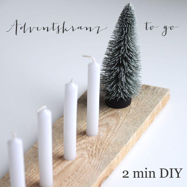 Ein einfaches, schnelles DIY für einen schlichten Adventskranz aus einem Holzbrett, vier Kerzen und einem Tannenbäumchen.