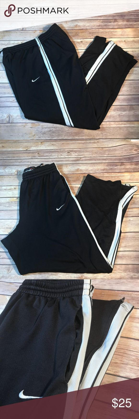 Nike basketball pants Black basketball pants with white stripe. Zippers at the bottom of the legs, pockets, drawstring. Has a few tiny snags that is normal for this type of material. One stitch loose in the seat but seam is still tight. Very bottom of white stripe is lightly stained, See pics.  🌷No lowballers, please 🌷Reasonable offers always welcome 🌷Bundle and save L2 Nike Pants