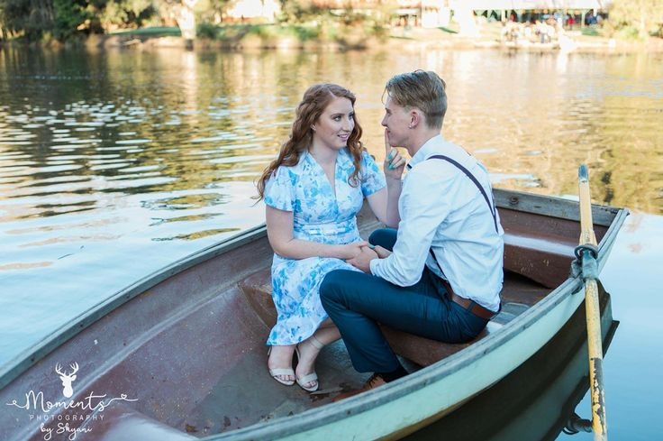 On a love boat by Moments Photography of Models Hannah Moy and Joel Brown. This tfp shoot was styled on a vintage row boat in new south wales australia for demonstration purpose for weddings and engagement styled photos.  I just love how it has so many movie, poem and painting inspired symbols such as kiss the girl from the little mermaid, the notebook lake scene, disney's tangled, Anne Of Green Gables, Lady of The Lake and even Thumberlina.  I think it is quirky, romantic and cute.