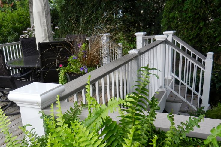 AFCO Series 200 Aluminum Rail in white with grey composite deck railing.