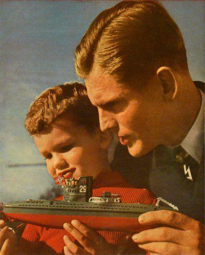 u-boot captain joachim schepke giving toy u-boot to horst plenk son of famous german skier tony plen...