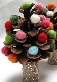 Pinecone Christmas Trees. Although first he painted it green and we tossed on some green glitter too! Then after it dried we put the pom poms in! So cute and corbs had a blast!