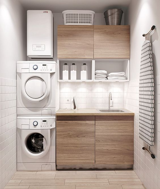 This modern minimalist laundry is small yet complete. Compact and efficiently designed.
