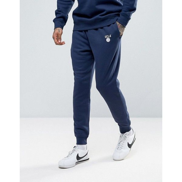 UCLA Logo Slim Fit Joggers ($40) ❤ liked on Polyvore featuring men's fashion, men's clothing, men's activewear, navy, mens athletic apparel, slim fit mens clothing, old navy mens clothing, slim and tall mens clothing and tall mens clothing