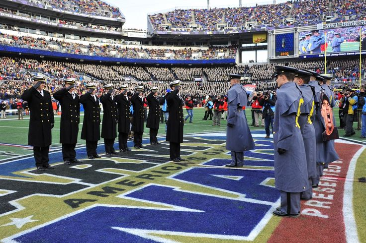http://www.businessinsider.com/army-navy-football-game-2014-12/#the-signs-are-not-what-youd-expect-to-see-at-a-college-football-game-these-midshipmen-waved-a-political-cartoon-depicting-the-american-colonies-as-a-fragmented-snake-12