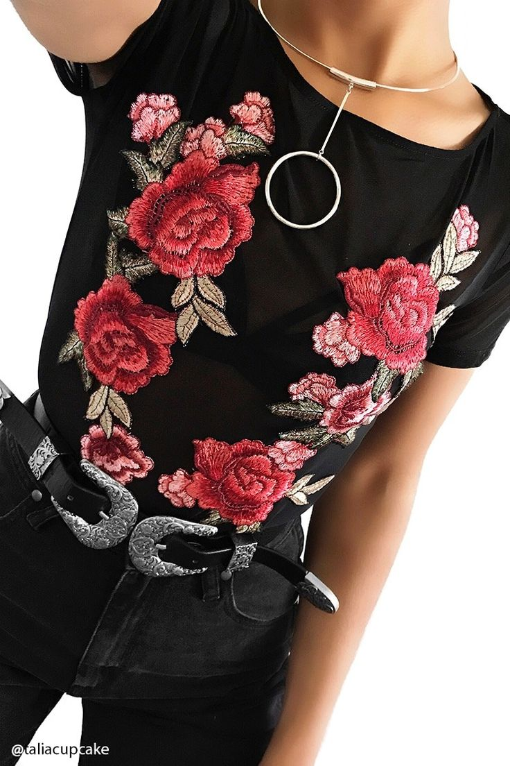 A sheer mesh knit bodysuit featuring a rose applique embroidery along the front, a round neckline, short sleeves, and a snap-button closure.