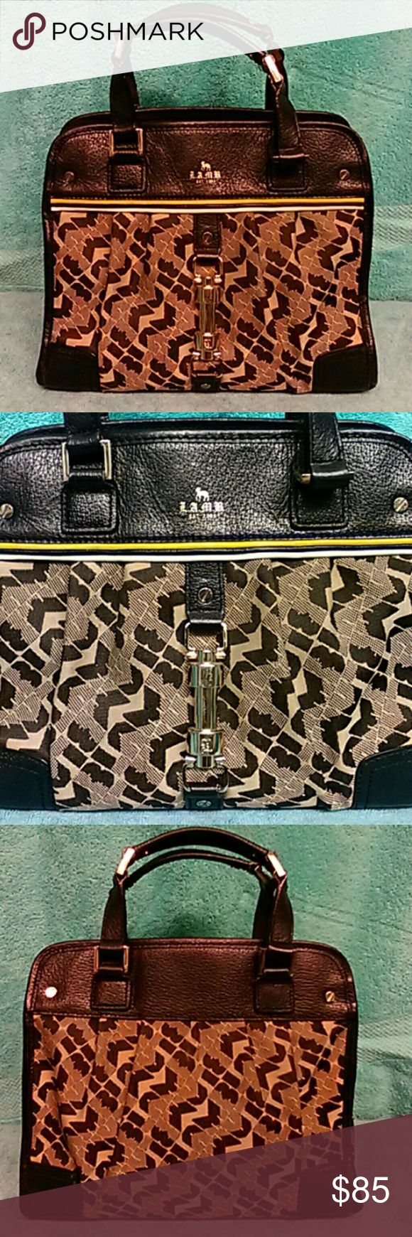 Authentic LAMB Signature Satchel Authentic Rare LAMB Signature Satchel. Leather trim, Beautiful goldtone hardware, fully lined with zipper compartment. Excellent condition. Lamb Bags Satchels