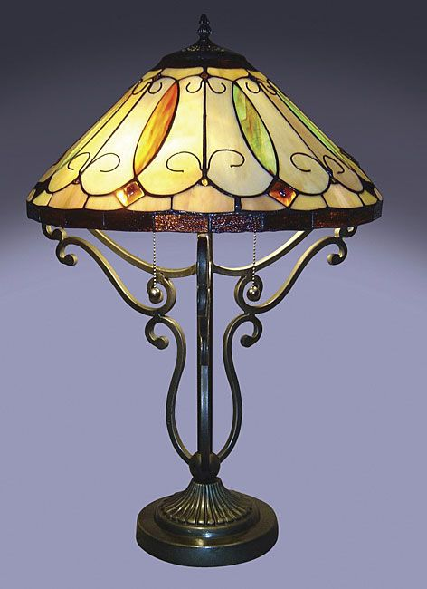 <br><li>Arroyo table lamp has been handcrafted using methods first developed by Louis Comfort Tiffany <li>Shade contains pieces of stained glass, each hand-cut and wrapped in fine copper foil<li>Lighting has metal bronze finished base
