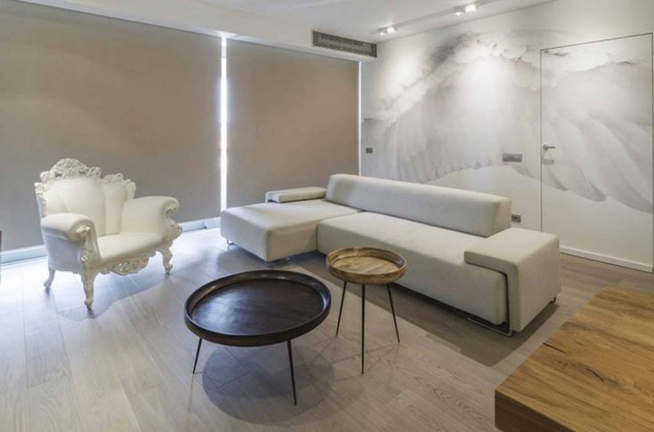 Apartments : Minimalist Apartment Living Room Design With L Shape White Bed Sofa And Round Shape Black Coffee Table Also Comfy White Armchair Idea Modern Apartment Sofa for Minimalist Interior Style Modern Sofas And Loveseats' Modern Apartment Sofa' Couches On Sale Or Clearance or Apartmentss