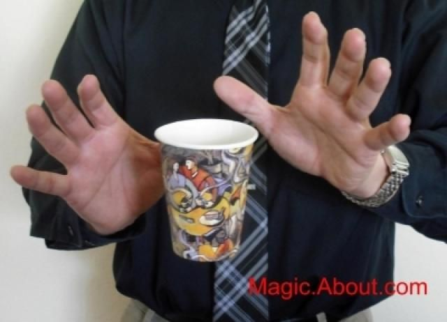 This is a first rate floating cup trick for beginners and kids. It all happens courtesy of a gimmicked cup that you can easily make and a bit of an illusion with your hands when you perform the trick. I offer instructions here.