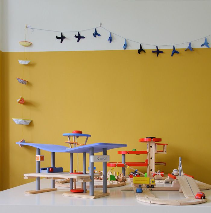 Yellow wall in our boysroom  http://bkids.typepad.com/intro/2013/01/bedroom_colors_yellow_kids_inspiration.html#