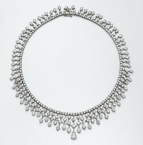 DIAMOND NECKLACE Designed as a line of round diamonds supporting a graduating fringe of round and  pear-shaped diamonds, the center anchored by a single pear-shaped diamond weighing approximately 1.45 carats, the balance of the diamonds weighing a total of approximately 47.75 carats, mounted in 18 karat white gold, length 16 inches.