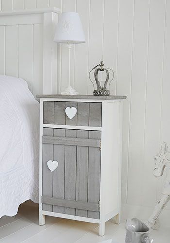The Cottage Kids Range from The White Lighthouse. White bedroom furniture including bedside tables, desks and storage. Our finishing touches make for a perfect children's bedroom. Our Heart Cottage grey and white bedside cabinet.