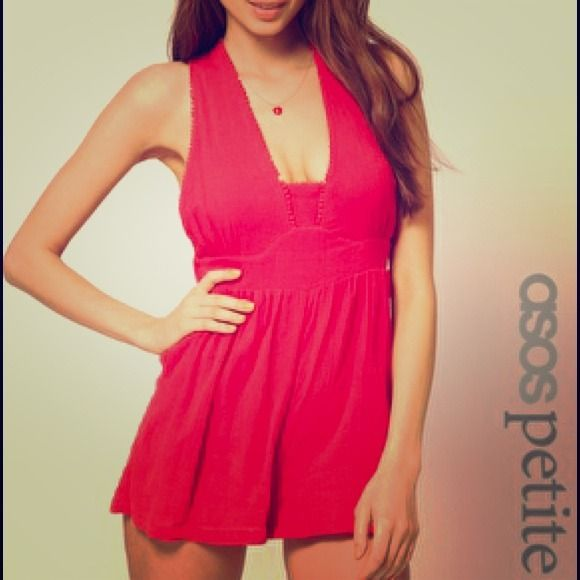 ASOS PETITE Playsuit ASOS PETITE play suit features a plunge neckline with a crochet trim, wide shoulder straps, a high, fitted waist with a wide, curved waistband, a wide cut to the legs with soft pleating and a cross over strap design and elasticated waistband to the reverse. 100% cotton. ASOS Other