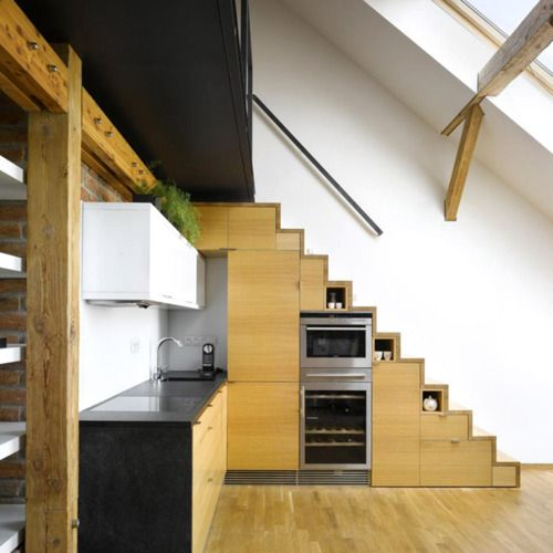 Mezzanine level for micro house with kitchen appliances in stairway