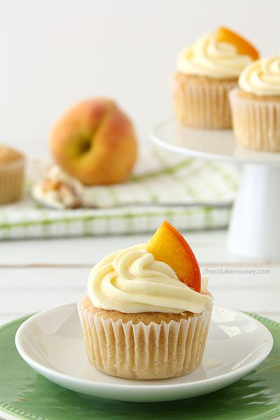 Peaches and Cream Stuffed Cupcakes with a peach pie and no bake cheesecake filling. Get the recipe at www.chocolatemoosey.com @chocolatemoosey