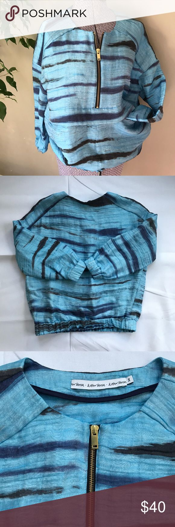 """S & Other Stories sporty blue top athleisure Upscale athleisure top by & Other Stories purchased in Berlin. Made of 58% linen, 26% polyamide, 16% silk. Front has a gold zipper and 2 discreet front pockets with a fold over flap. Elastic hem and cuffs. Size 34, would fit a small, measures: 23"""" long; 40"""" bust; hem stretches from 33"""" — 36""""; 23"""" shoulder; 15"""" sleeve; 14"""" armhole;!cuff stretches from 8""""—10"""".  Cute worn styled like upscale athleisure with tight stretchy skirts or flared wide leg…"""