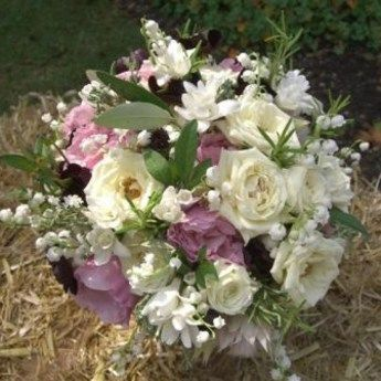 Beautiful old fashioned roses, chocolate cosmos, lily of the valley and fragrant foliage.