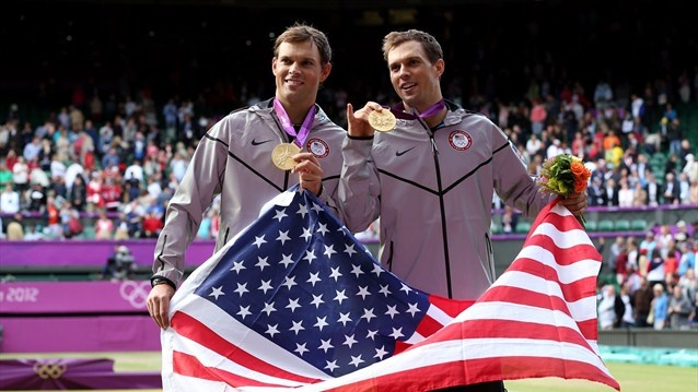 Mike Bryan and Bob Bryan pose with their gold medals and American flag after defeating Jo-Wilfried Tsonga and Michael Llodra of France in their Men's Doubles Tennis final match on Day 8