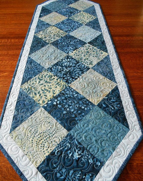 This beautiful blue batik table runner features varying shades of blue, from deep indigo to icy blue. The blocks are from Modas Cold Spell batik
