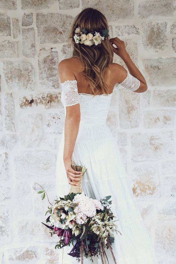 off the shoulder lace wedding dress, flowers in hair are ideal for a spring boho bride