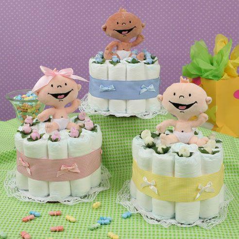 Маленькие тортики из памперсов для девочек и мальчиков украшенные цветами и игрушками.